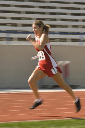 Female track athlete sprinting Stock Photo - 5476021