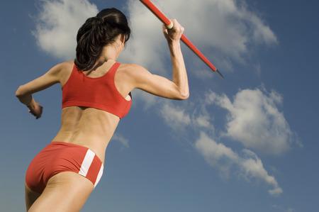 javelin: Female athlete throwing javelin