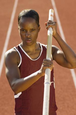女性の運動選手棒高跳びの準備 写真素材 - 5476027
