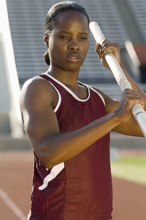 Female athlete preparing for pole jump Stock Photo - 5476028