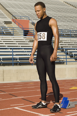 Male track athlete standing on track Stock Photo - 5476055