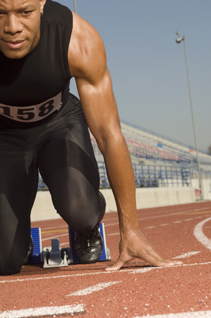 Male track athlete on starting block Stock Photo - 5476056