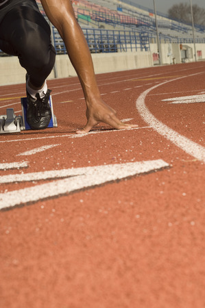 Male track athlete on starting block Stock Photo - 5476057
