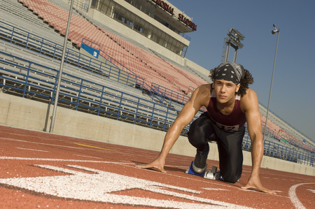 Runner on a track in starting block Stock Photo - 5476058