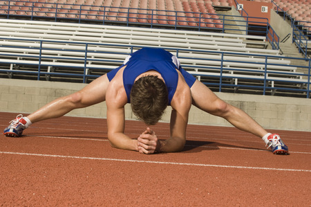 Runner on a track, stretching Stock Photo - 5476062