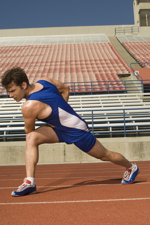 Runner on a track, stretching Stock Photo - 5476065