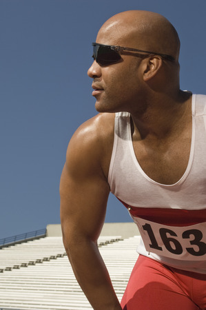Runner with sunglasses on a track Stock Photo - 5476068