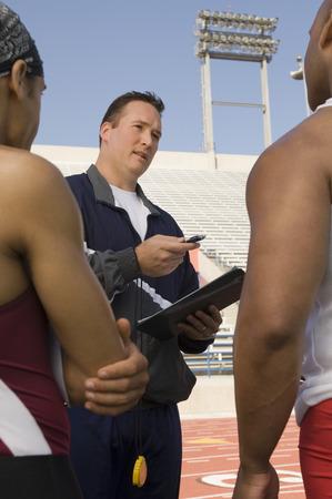 instructing: Trainer instructing runners