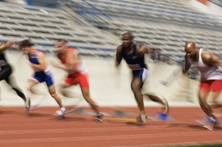 Runners running on a track Stock Photo - 5476079