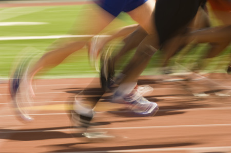 low section: Low section of runners running on a track