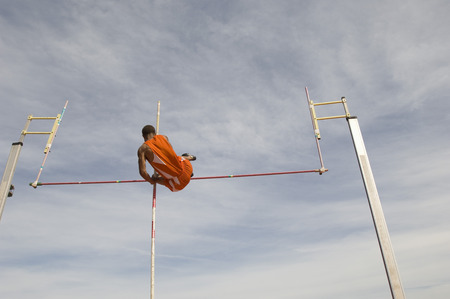 vaulted: Pole vaulted in mid-air, low angle view LANG_EVOIMAGES