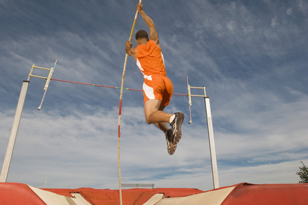 Pole vaulted taking off Stock Photo - 5476093