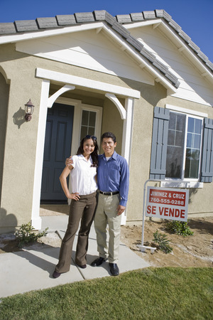 Young couple in front of new house Stock Photo - 5476144