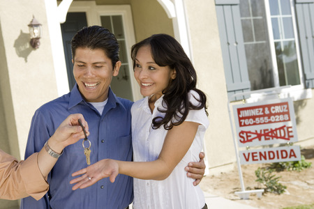 Young couple buying house, taking keys Stock Photo - 5476147