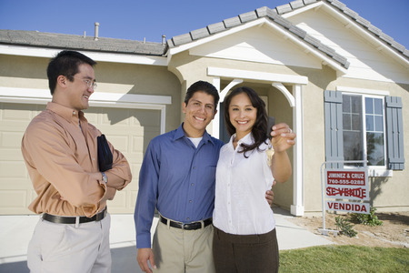 Young couple buying house, holding keys Stock Photo - 5476148
