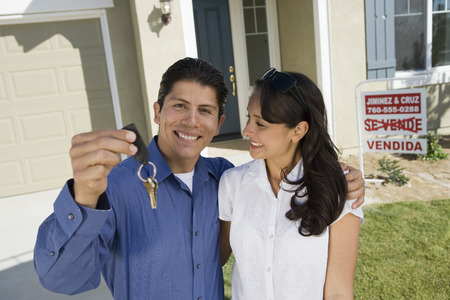 Young couple holding keys outside new home, portrait Stock Photo - 5476150
