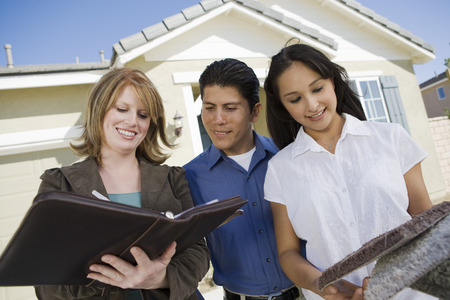Young couple buying house, signing contract Stock Photo - 5476152
