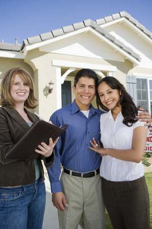 Young couple buying house, signing contract Stock Photo - 5476154