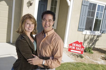 Couple in front of new house, portrait Stock Photo - 5476156