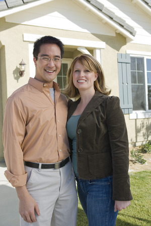 Couple in front of new house, portrait Stock Photo - 5476157