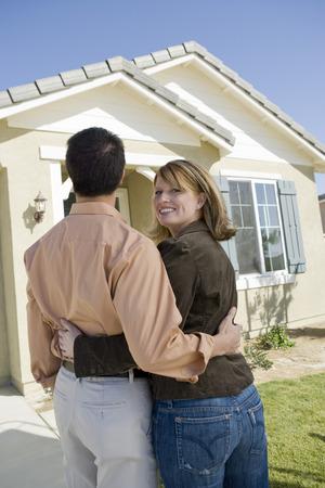 Couple admiring new house Stock Photo - 5476158
