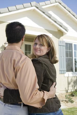 Couple admiring new house Stock Photo - 5476159