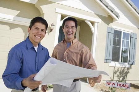 Architect showing house plans Stock Photo - 5476162