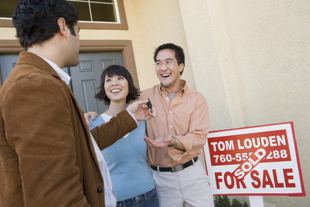 Mid adult couple receiving keys to their new home Stock Photo - 5476170