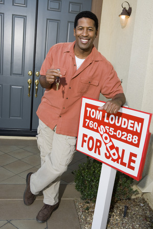 Man holding keys to his new home Stock Photo - 5476179