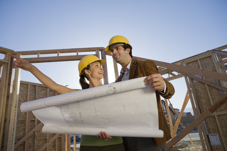Young couple examining blueprint in construction site Stock Photo - 5476187