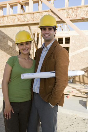 Young couple in construction site Stock Photo - 5476188
