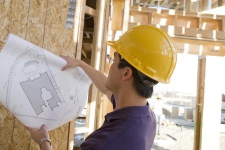 Worker holding blueprint in construction site Stock Photo - 5476195