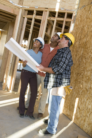 Young couple with construction worker in construction site Stock Photo - 5476196