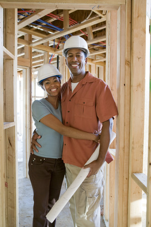 Young couple on building site Stock Photo - 5476197