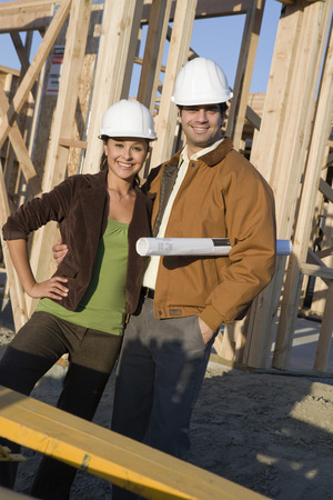 Young couple in construction site Stock Photo - 5476200