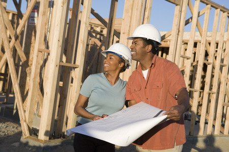 Young couple in construction site Stock Photo - 5476201