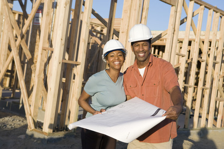 Young couple in construction site Stock Photo - 5476202