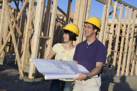 Young couple in construction site Reklamní fotografie