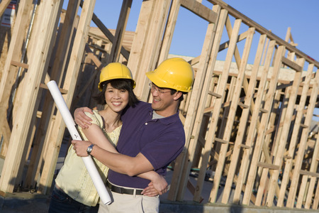 Young couple in construction site Stock Photo - 5476205