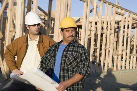 Architect with construction worker in construction site Stock Photo - 5476207