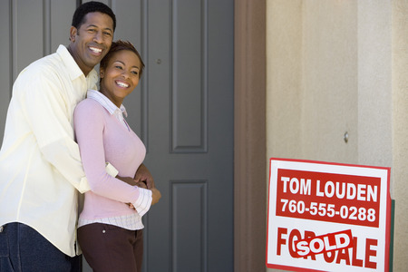 Smiling couple outside their new home Stock Photo - 5476221