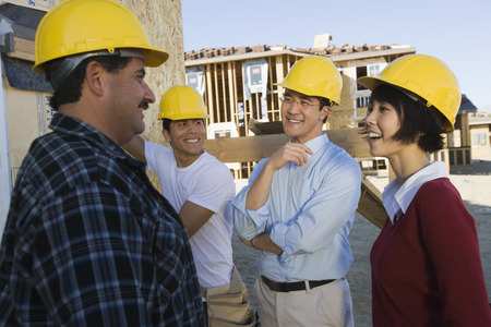 Smiling couple with construction workers Stock Photo - 5476234