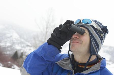 early 30s: Skier Looking Through Binoculars