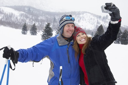 winter escape: Skiing Couple Posing for Photo