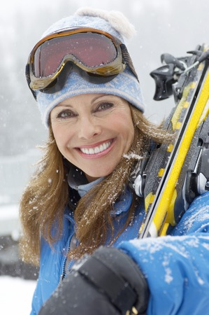 only mature women: Woman with Alpine Skis