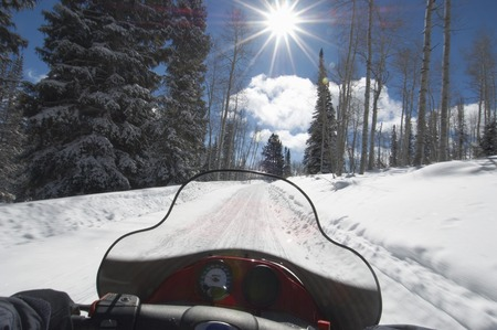 Driving a Snowmobile Stock Photo - 5476279