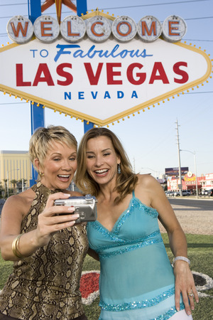 Two women in front of Welcome to Las Vegas sign Stock Photo - 5476299