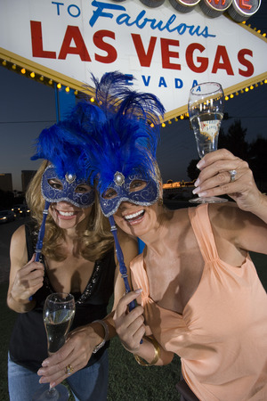 Two women celebrating in front of Welcome to Las Vegas sign Stock Photo - 5476317