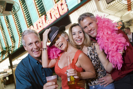Two men and two women in front of casino building, portrait Stock Photo - 5476327