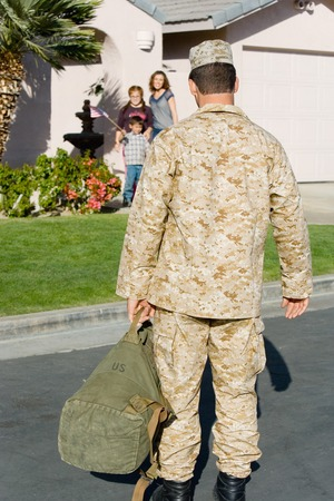 one person with others: Soldier Returning Home